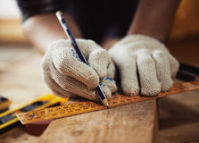 Craftsman measuring plank Stock Image