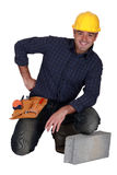 Craftsman next to a stone block Stock Image