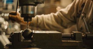 Craftsman operate a drill press. Royalty Free Stock Images