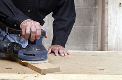 Craftsman orbital sanding oak wood Royalty Free Stock Images