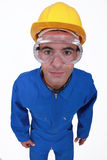 Craftsman in overalls. Wearing protection glasses Stock Photo