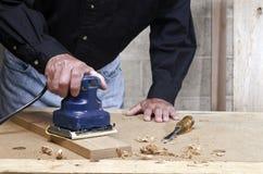 Craftsman pad sanding oak wood Stock Image