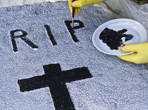 Craftsman paints a tombstone halloween Royalty Free Stock Photography