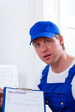 Craftsman or plumber giving overpriced invoice Royalty Free Stock Photography