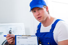 Craftsman or plumber giving overpriced invoice Royalty Free Stock Photos
