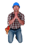 Craftsman praying Stock Images