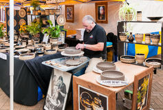 Craftsman is producing ceramic pots Royalty Free Stock Photos