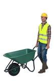Craftsman pushing a wheelbarrow Royalty Free Stock Images
