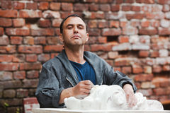 Craftsman restorer is proud of his work Royalty Free Stock Images