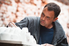Craftsman restorer working with gypsum Royalty Free Stock Photo