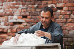 Craftsman restorer working with gypsum Royalty Free Stock Photography