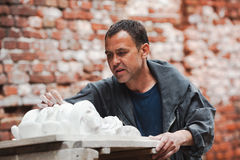Craftsman restorer working with gypsum Royalty Free Stock Image