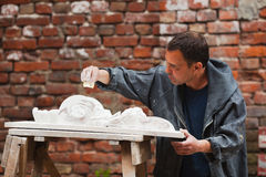 Craftsman restorer working with gypsum model Royalty Free Stock Images