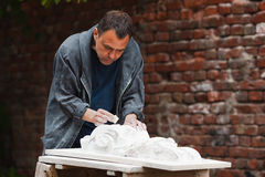 Craftsman restorer working with gypsum model Stock Image