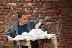 Craftsman restorer working with gypsum model Royalty Free Stock Photos