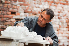 Craftsman restorer working with gypsum model Royalty Free Stock Photography