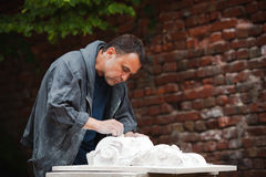 Craftsman restorer working with gypsum model Stock Photo