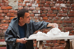 Craftsman restorer working with gypsum model Stock Photography