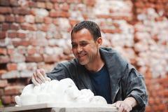 Craftsman restorer working with gypsum model Stock Image