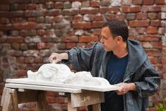 Craftsman restorer working with gypsum model Stock Photo