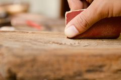 Craftsman Run the sandpaper across the surface wood. Carpenter and architect at work concept Royalty Free Stock Photo