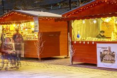Craftsman`s cottages with illuminations of Christmas around on the main square of downtown nio Royalty Free Stock Photo