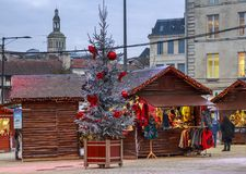 Craftsman`s cottages with illuminations of Christmas around on the main square of downtown nio Stock Photos
