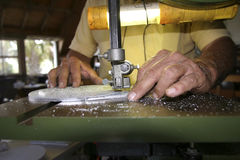 Craftsman's Hands. Craftsman cutting a metal template Stock Images