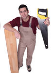 Craftsman with saw Royalty Free Stock Photography