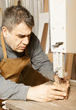 Craftsman sawing billet Stock Photography