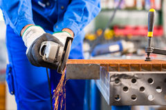 Craftsman sawing with disk grinder Stock Image