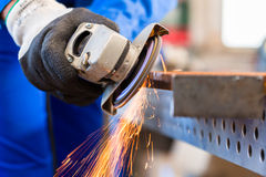 Craftsman Sawing With Disk Grinder Stock Photography