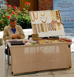 Craftsman sells jewelry made of amber near Museum of Amber in Kaliningrad Royalty Free Stock Photography