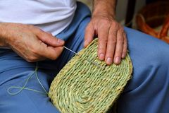 Craftsman sewing basket esparto grass weaver Royalty Free Stock Photography