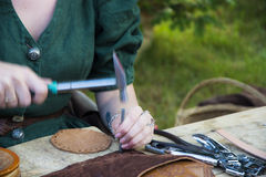 Craftsman Sewing Leather Items Stock Image
