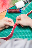 Craftsman sews belt for new leather bag Royalty Free Stock Image