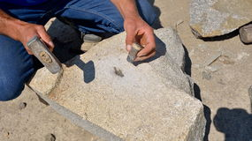 Craftsman shaping stone Royalty Free Stock Image