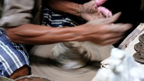 Craftsman shaving the clay pot lid for perfect shape. For selling consumer stock video