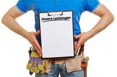Craftsman showing German slogan Royalty Free Stock Photography
