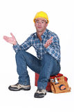 Craftsman sitting on his toolbox Stock Photos
