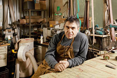 Craftsman sitting in workshop Stock Image