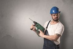 Craftsman standing in front of an empty wall. Royalty Free Stock Photos