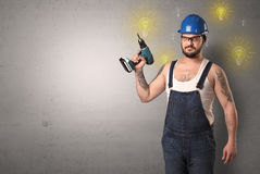 Craftsman standing with instrument. Royalty Free Stock Photo