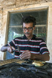A craftsman starts the process of making a brass container at Sigiriya in Sri Lanka. Royalty Free Stock Photo