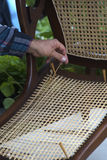 Craftsman stringing a chair bottom. Royalty Free Stock Photos