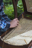 Craftsman stringing a chair bottom. Stock Photography