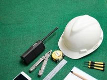 Craftsman tool, building equipment for man worker, safety white helmet, walkie-talkie, Portable radio transceiver, mobile phone, p. Liers, ruler, book Stock Image