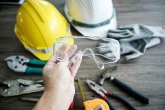 Free Craftsman Tool, For Man Worker. Glasses Safety In Hand Royalty Free Stock Photo - 120127675