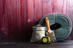 Craftsman tool such as string rope, paint brushes, and old nails in sacks. 1 stock photography