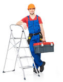 Craftsman with tools and stairs Royalty Free Stock Image